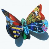 A butterfly coin bank and sculpture that is great fun for girls.